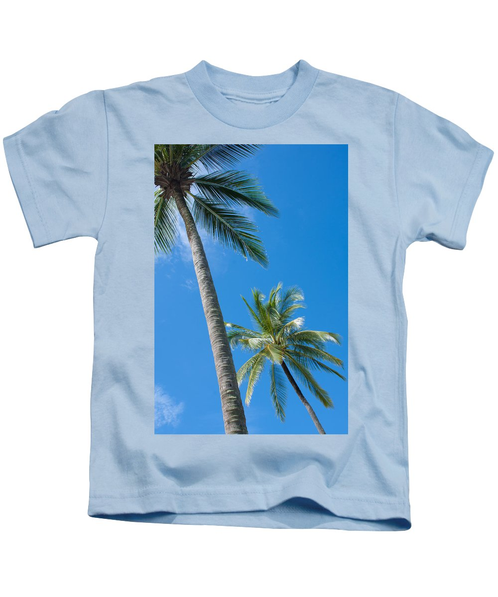 Background Kids T-Shirt featuring the photograph Coconuts by Atiketta Sangasaeng