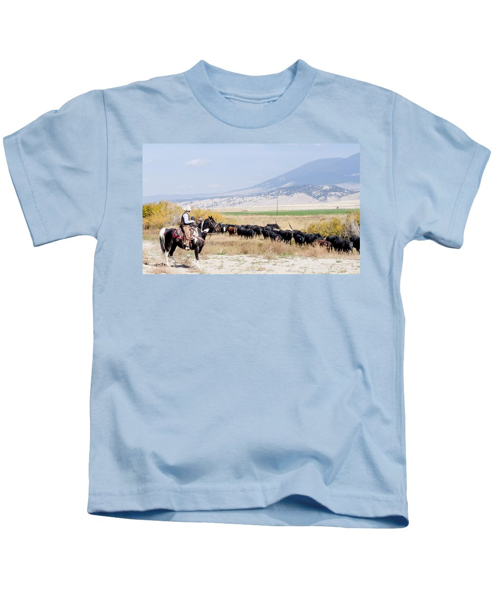 Cowboy Kids T-Shirt featuring the photograph Moving The Herd by Fran Riley