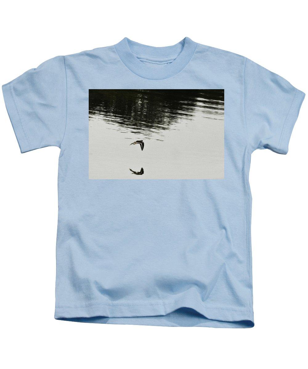 Bird In Flight Over Lake-reflection Kids T-Shirt featuring the photograph Reflection Of Flight by Douglas Barnard