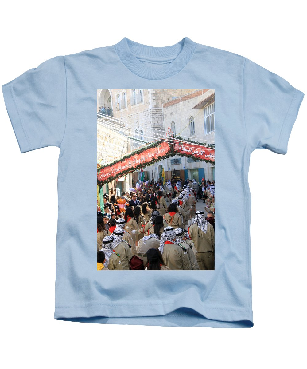 Scouts Kids T-Shirt featuring the photograph Scouts Marching During Christmas Parade In Bethlehem by Munir Alawi