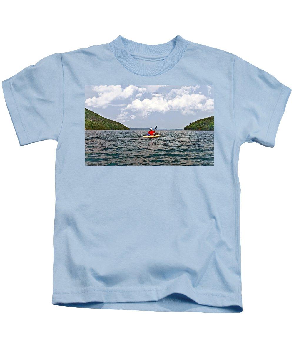 Man Kids T-Shirt featuring the photograph Solitary Man In Kayak by Susan Leggett