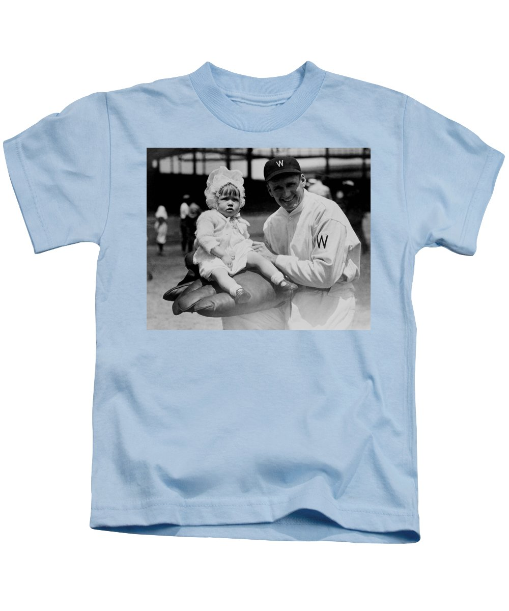 walter Johnson Kids T-Shirt featuring the photograph Walter Johnson Holding A Baby - C 1924 by International Images