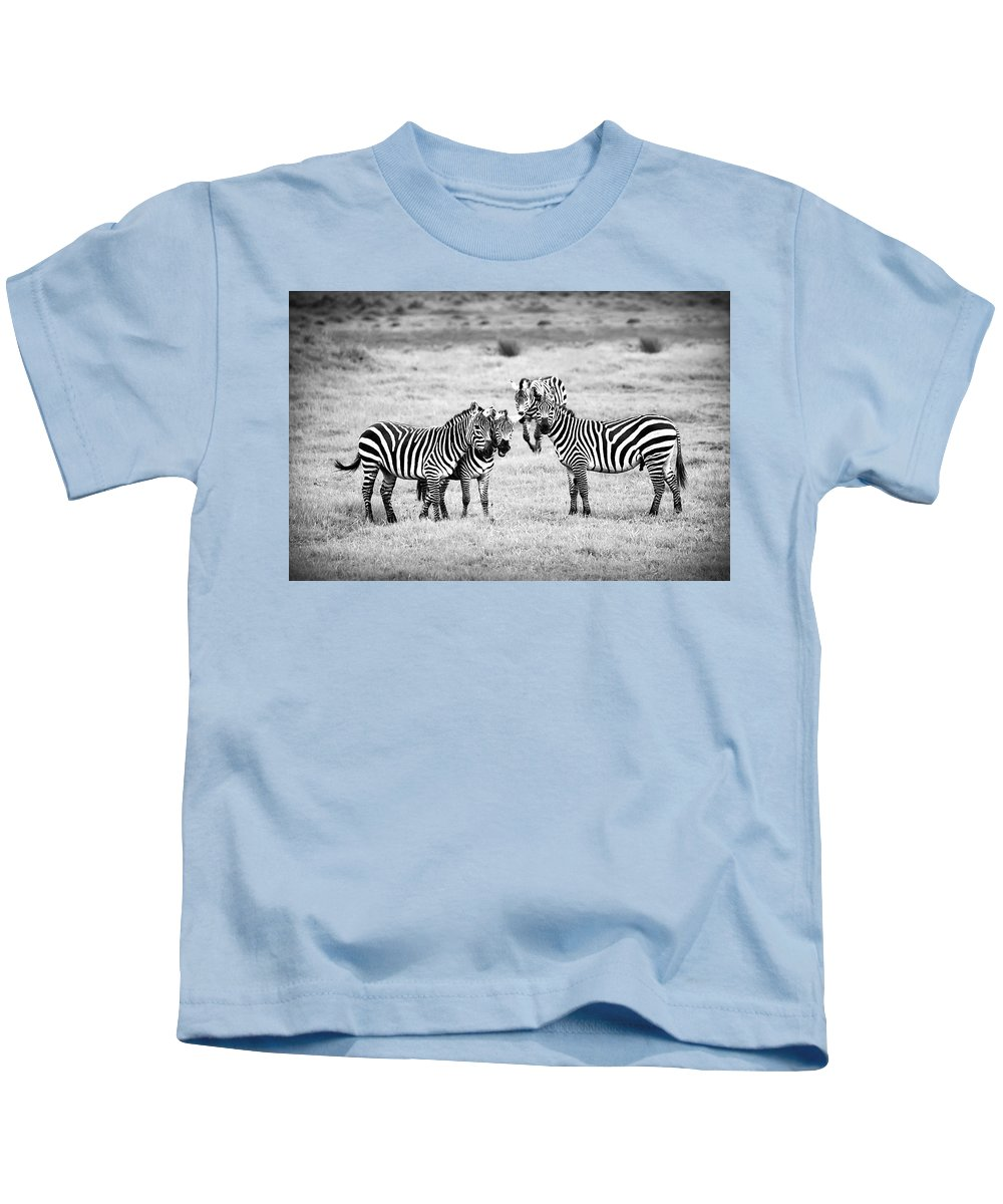 Africa Kids T-Shirt featuring the photograph Zebras In Black And White by Sebastian Musial