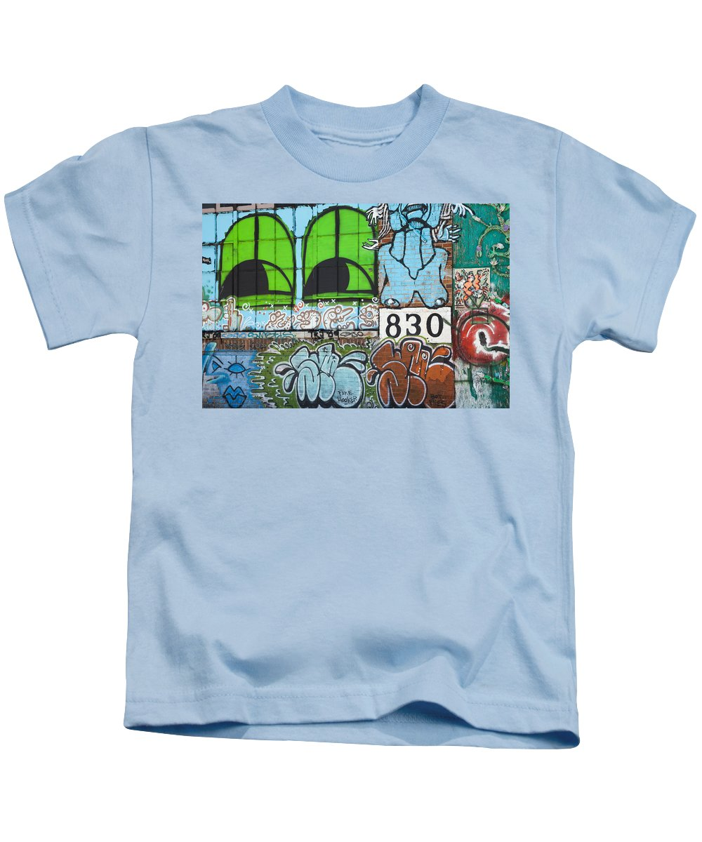 Graffitti 59th St. New York Kids T-Shirt featuring the photograph Graffiti #5781 by John Stuart