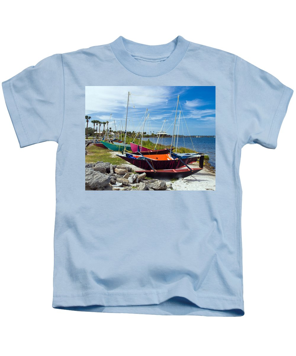 Sail; Sailing; Boat; Sailboat; Mast; Plywood; Homemade; Boy; Scouts; Fleet; Class; Dragon; Tiller; F Kids T-Shirt featuring the photograph Beached In Sebastian Florida by Allan Hughes