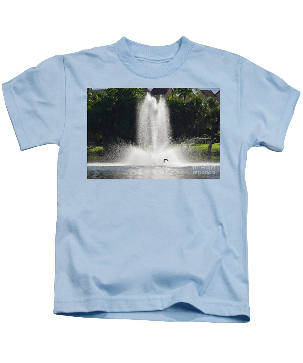 Heron Kids T-Shirt featuring the photograph Heron Across A Fountain by William Tasker