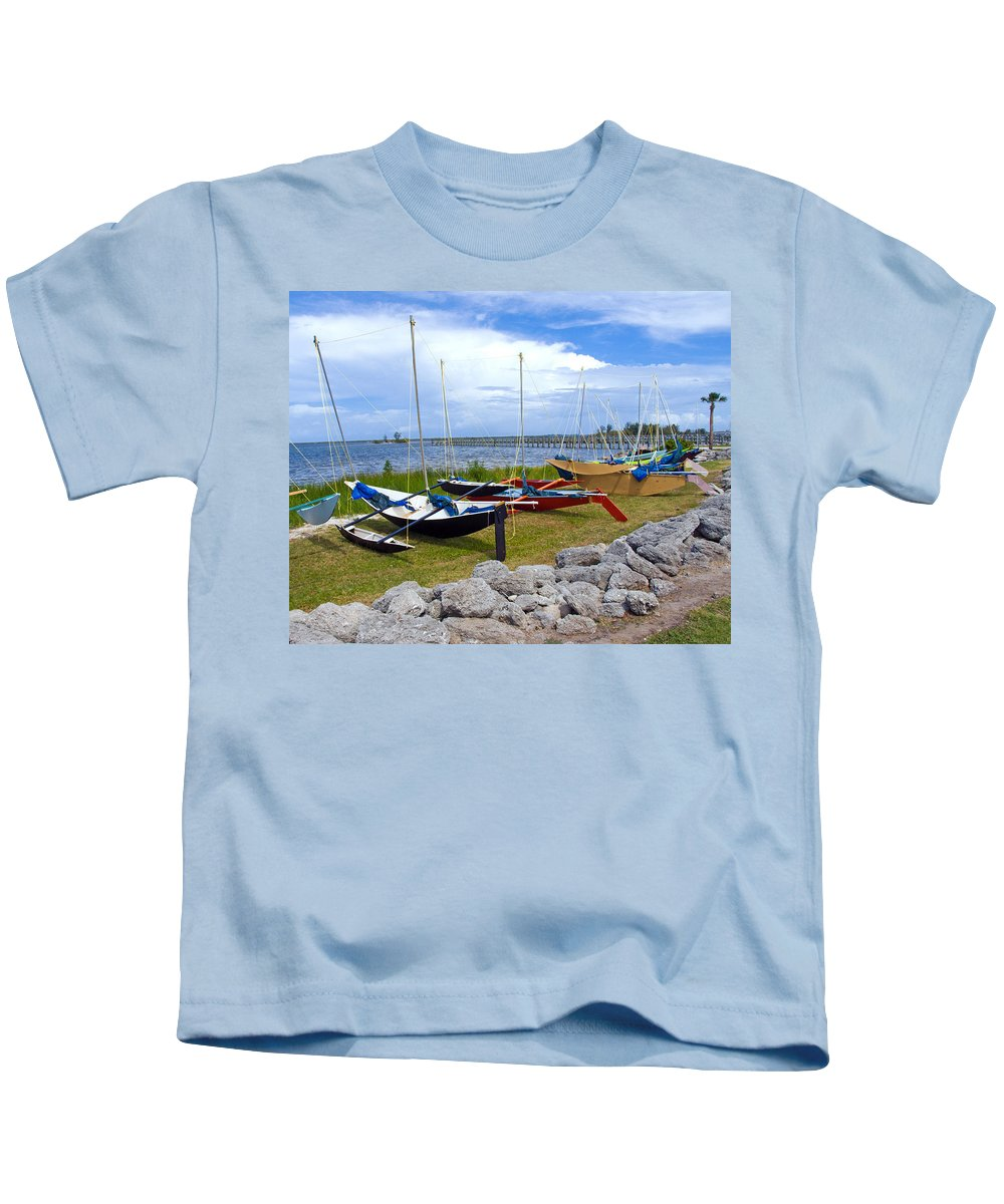 Sail; Sailing; Boat; Sailboat; Mast; Plywood; Homemade; Boy; Scouts; Fleet; Class; Dragon; Tiller; F Kids T-Shirt featuring the photograph Homemade Outriggers Canoes On The Indian River Lagoon In Florida by Allan Hughes