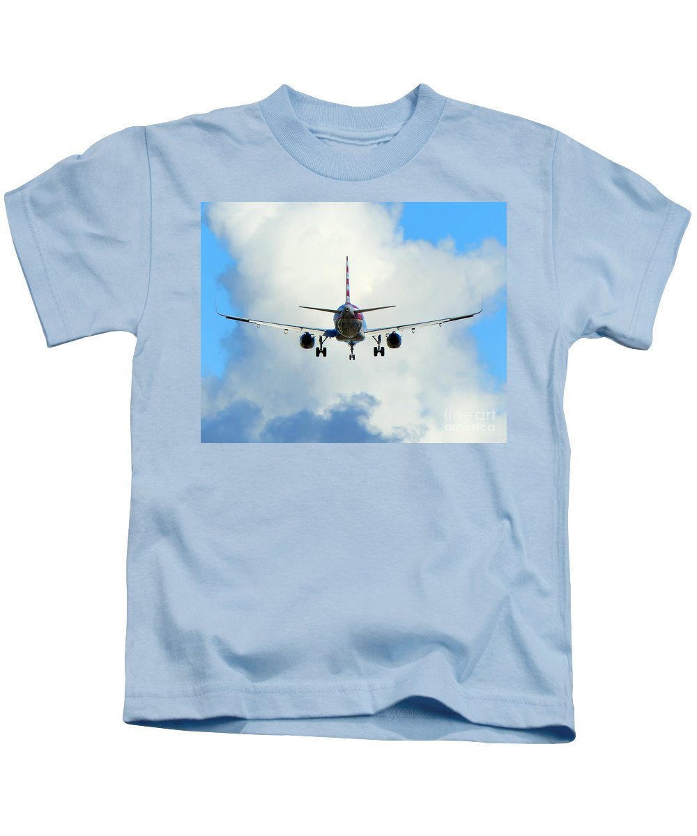 Jet Airliner Kids T-Shirt featuring the photograph Into The Clouds by Carlos Amaro