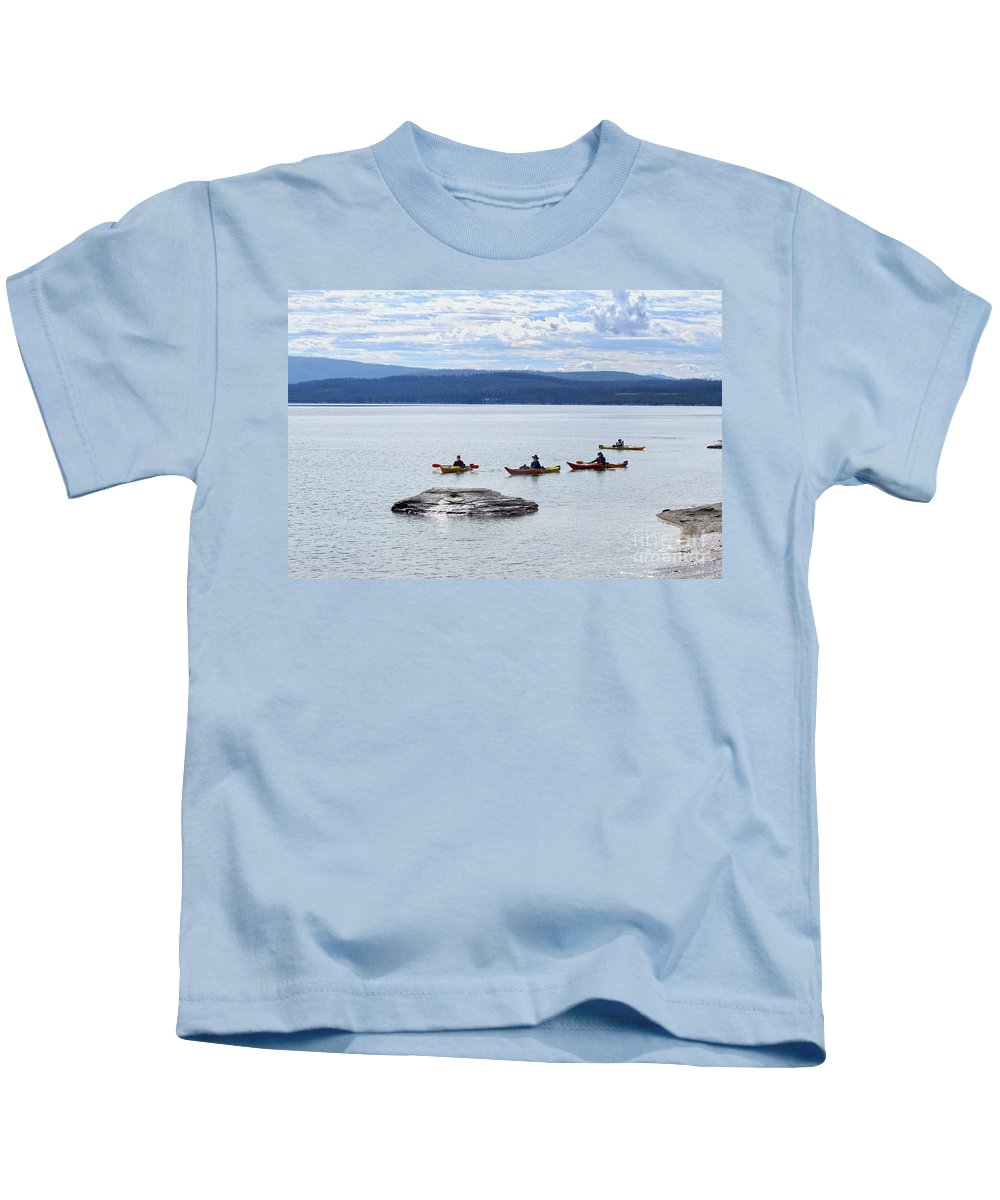 Yellowstone Lake Kids T-Shirt featuring the photograph Kayakers Paddle To Fishing Cone On Yellowstone Lake by Catherine Sherman