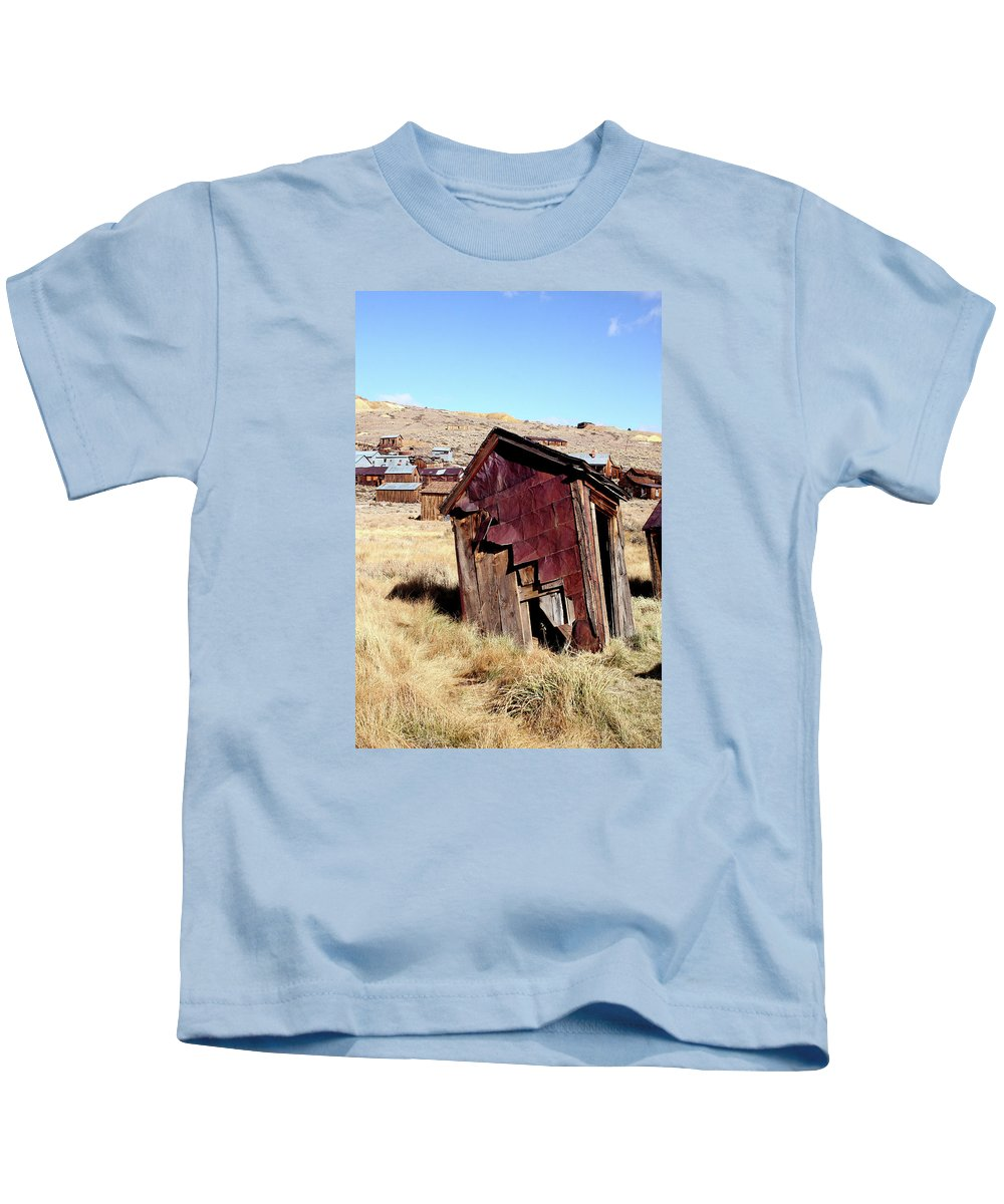Bodie Ghost Town Kids T-Shirt featuring the photograph Leaning Bodie Outhouse by Art Block Collections