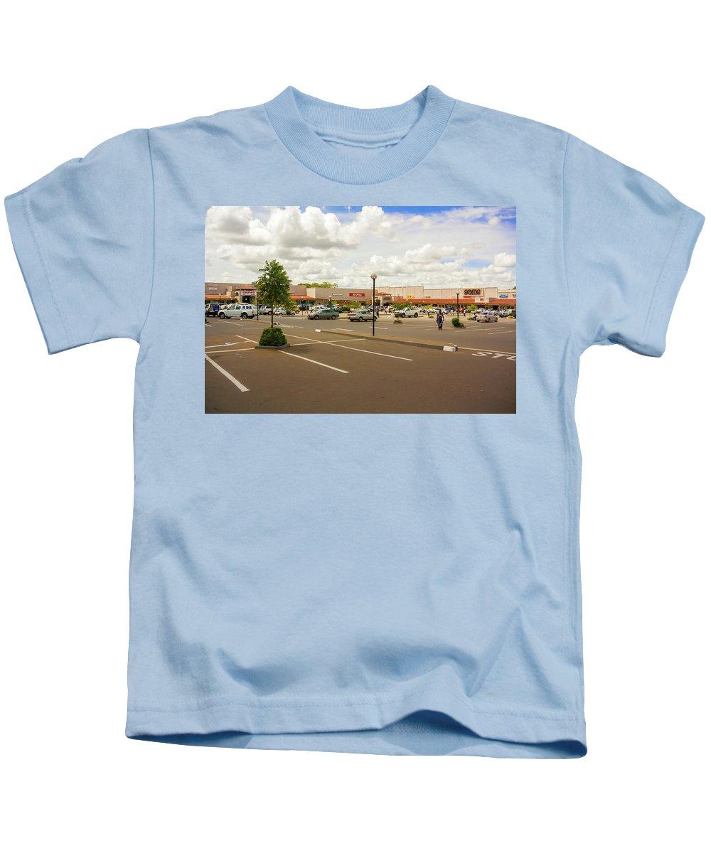 Capital Kids T-Shirt featuring the photograph Lilongwe City Mall by Marek Poplawski