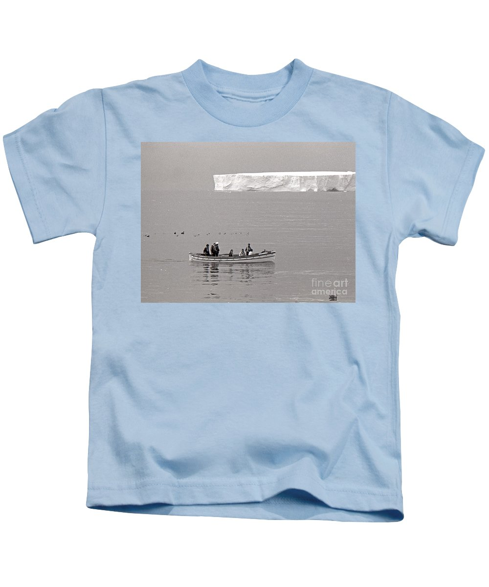 Iceberg Kids T-Shirt featuring the photograph Lone Giant Iceberg And Small Sea Boat by Wilf Doyle