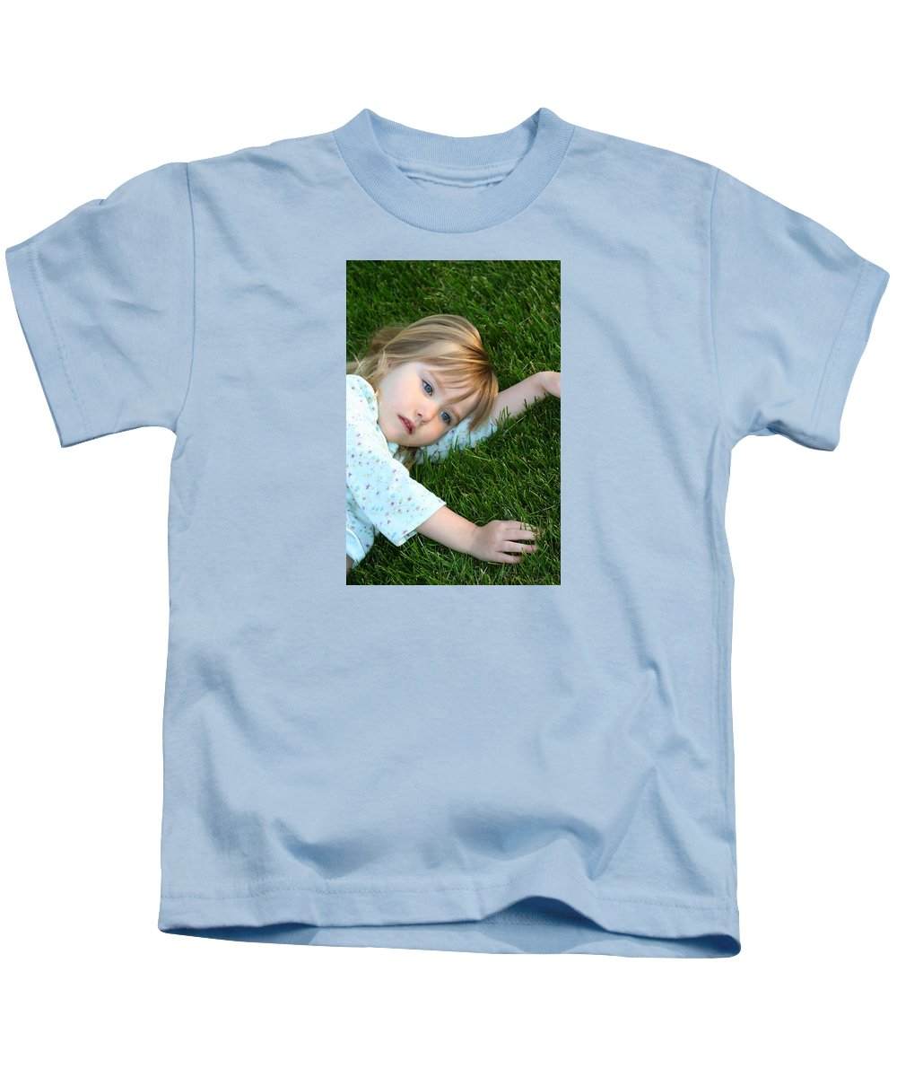 Girl Kids T-Shirt featuring the photograph Lying In The Grass by Margie Wildblood