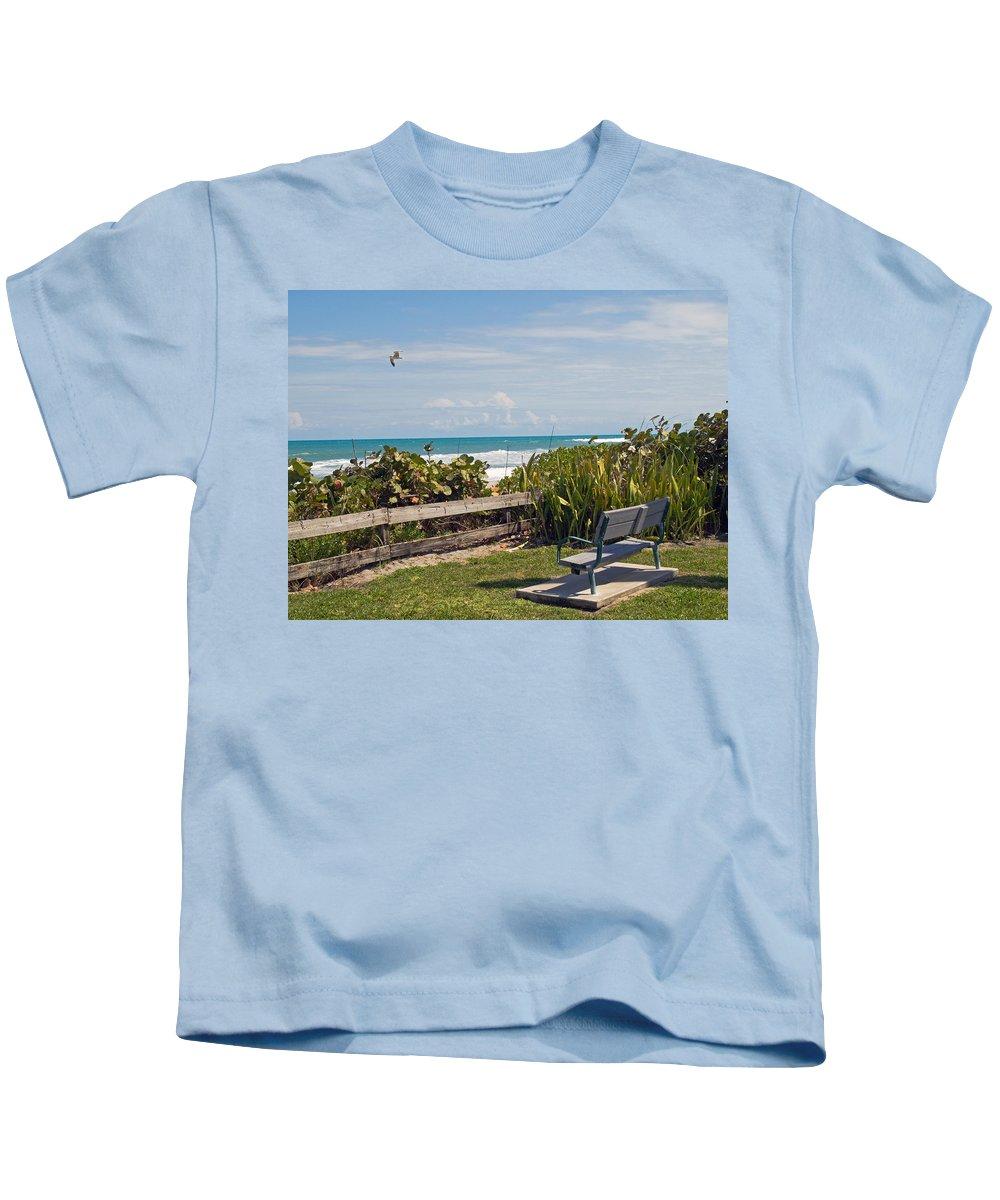 Bench; Public; Florida; Melbourne; Beach; Coast; Shore; Surf; Sand; Brevard; Space; Ocean; Sea; Atla Kids T-Shirt featuring the photograph Melbourne Beach In Florida Usa by Allan Hughes