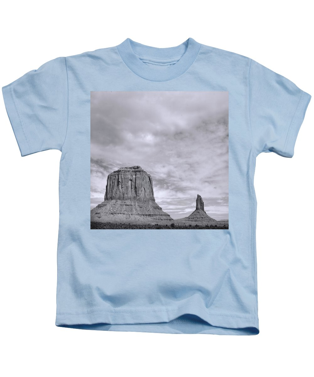 Arizona; Utah: United States; Usa; Southwest; Clouds; America; American; Beauty; Black; Deep; Desert; Environment; Erosion; Formation; Geology; Grand; Kids T-Shirt featuring the photograph Monumentvalley 41 by Ingrid Smith-Johnsen