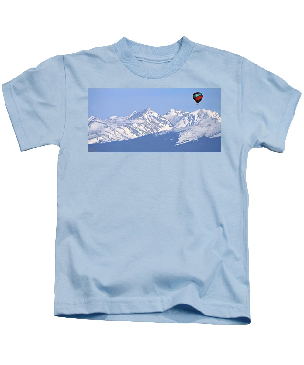 Rockies Kids T-Shirt featuring the photograph Over The Rockies by Scott Mahon