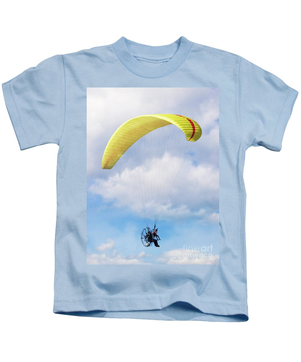 Power Kids T-Shirt featuring the photograph Paraglider Floating In The Clouds by Bob Zuber