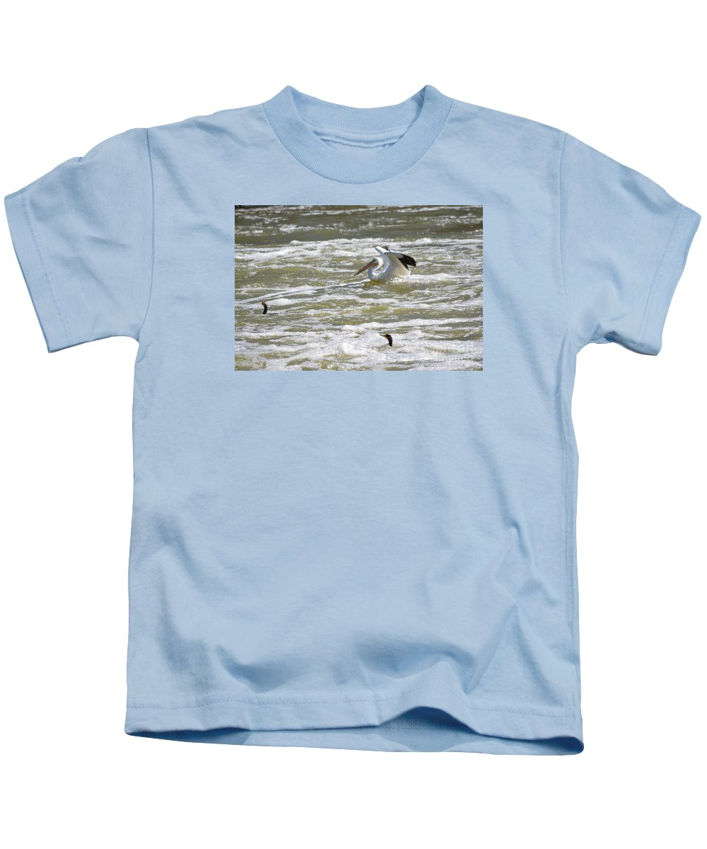 Pelican Landing And Cormorants Prints Kids T-Shirt featuring the photograph Pelican Landing And Cormorants by Ruth Housley
