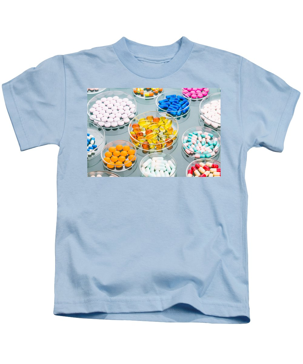 Capsule Kids T-Shirt featuring the photograph Pharmaceuticals by Voisin/Phanie