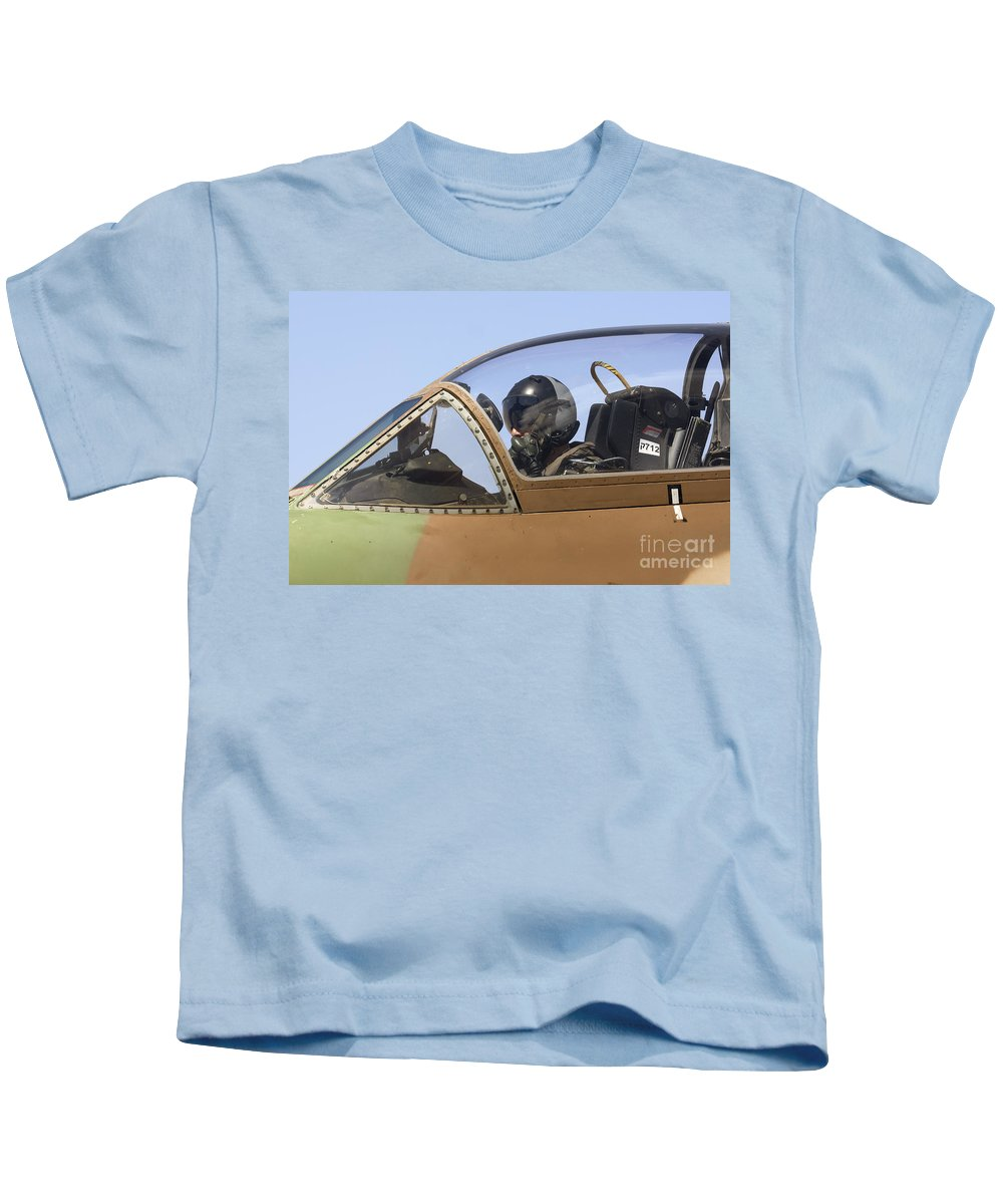 Aircraft Kids T-Shirt featuring the photograph Pilot In The Cockpit Of A Skyhawk Fighter Jet by Nir Ben-Yosef