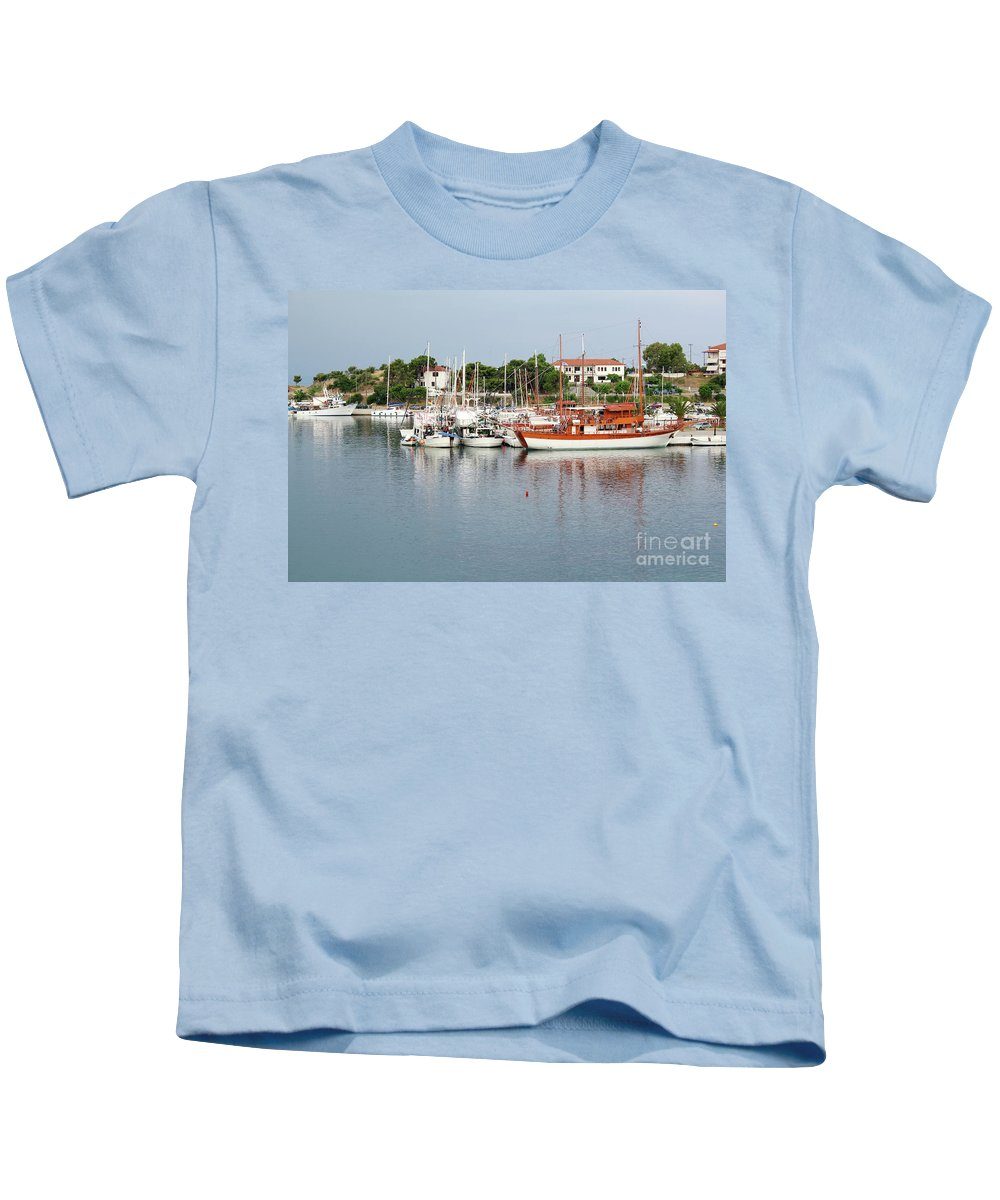 Ship Kids T-Shirt featuring the photograph Port With Sailboat And Fishing Boat by Goce Risteski