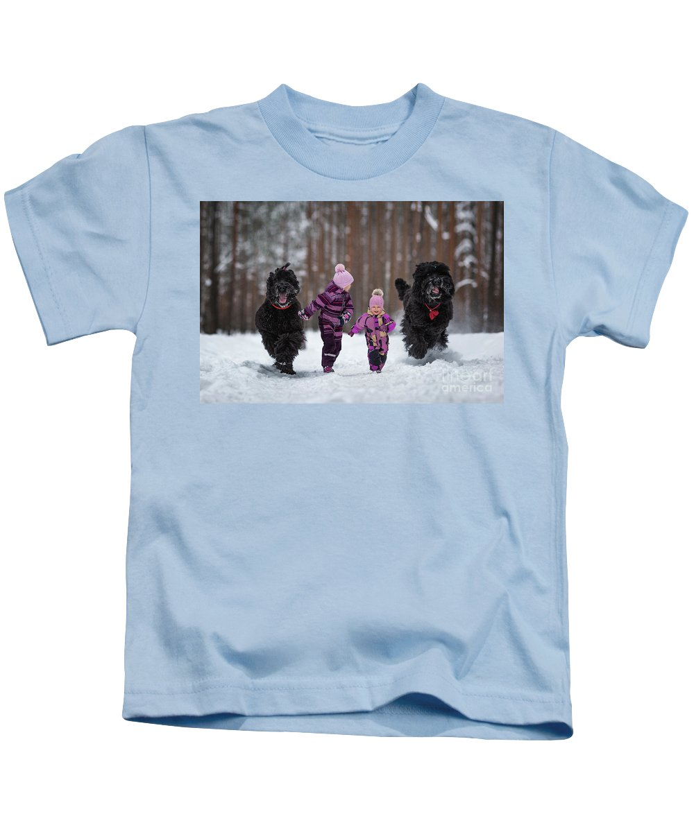 Black Russian Terriers Kids T-Shirt featuring the photograph Race You by Andy Seliverstoff