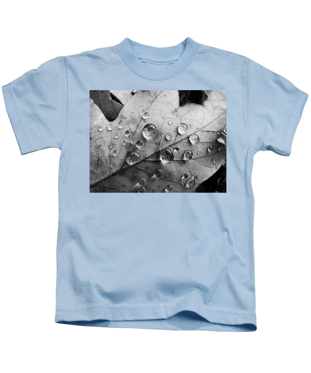 Drops Kids T-Shirt featuring the photograph Raindrops by Daniel Csoka
