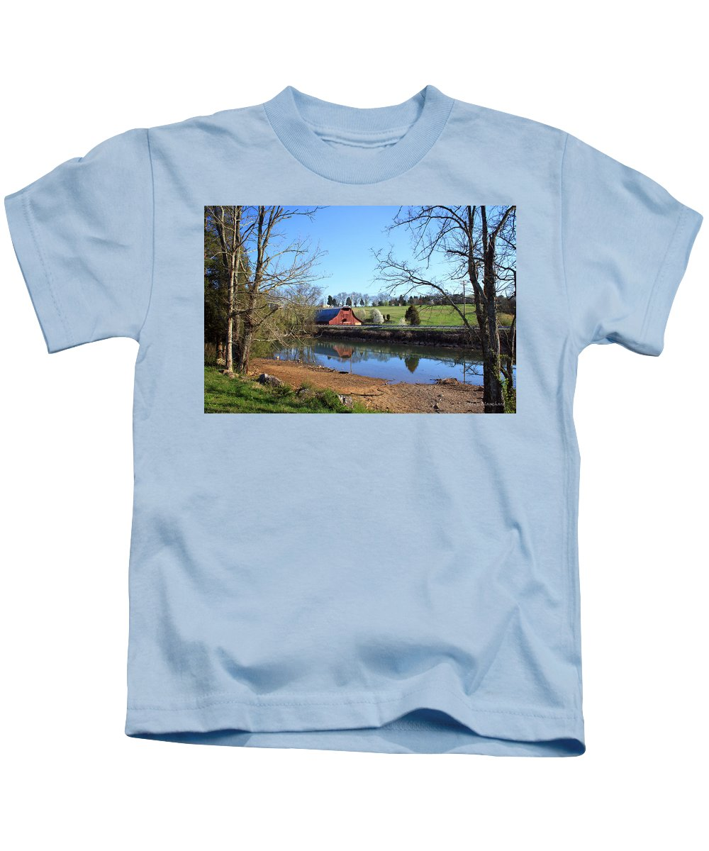 Landscape Kids T-Shirt featuring the photograph Red Barn And Pond by Todd Blanchard