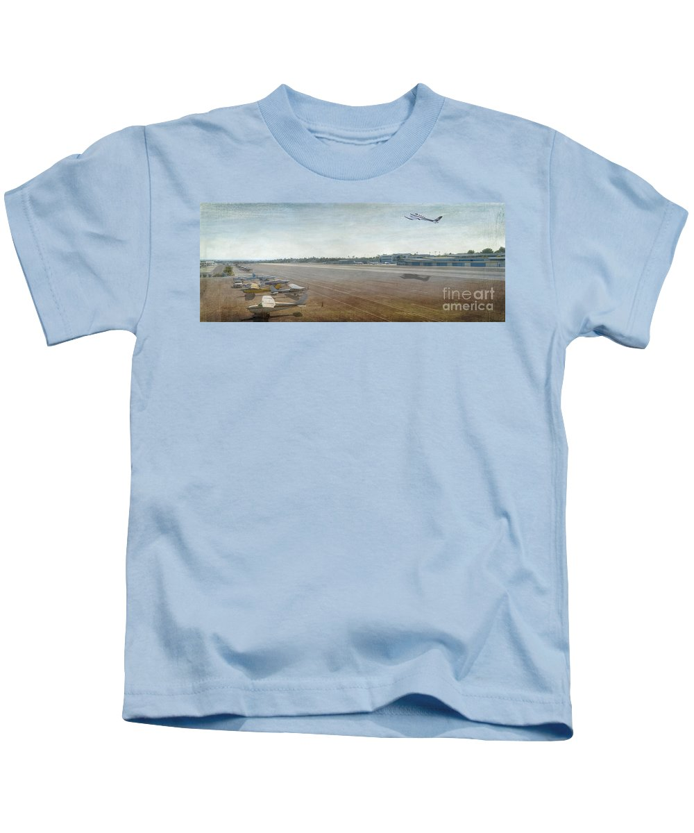 City Airport Kids T-Shirt featuring the photograph Small City Airport Plane Taking Off Runway by David Zanzinger