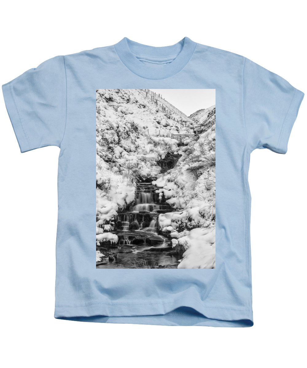 Black And White Kids T-Shirt featuring the photograph Snowy Waterfall In The Peak District In Derbyshire by Neil Alexander