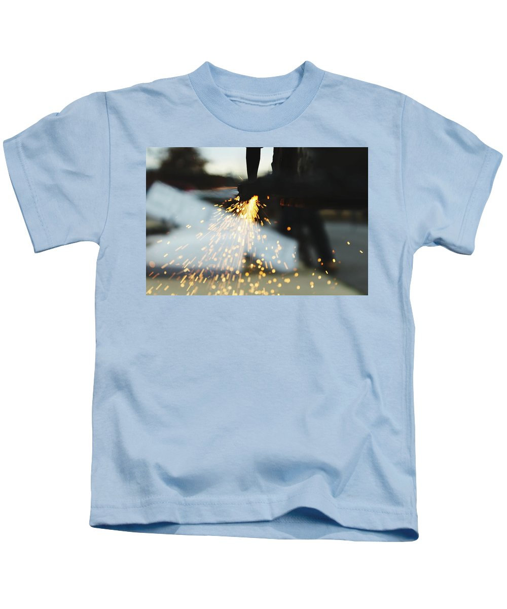 Sparks Kids T-Shirt featuring the photograph Sparks From Cutting Metal by Hunter Kotlinski