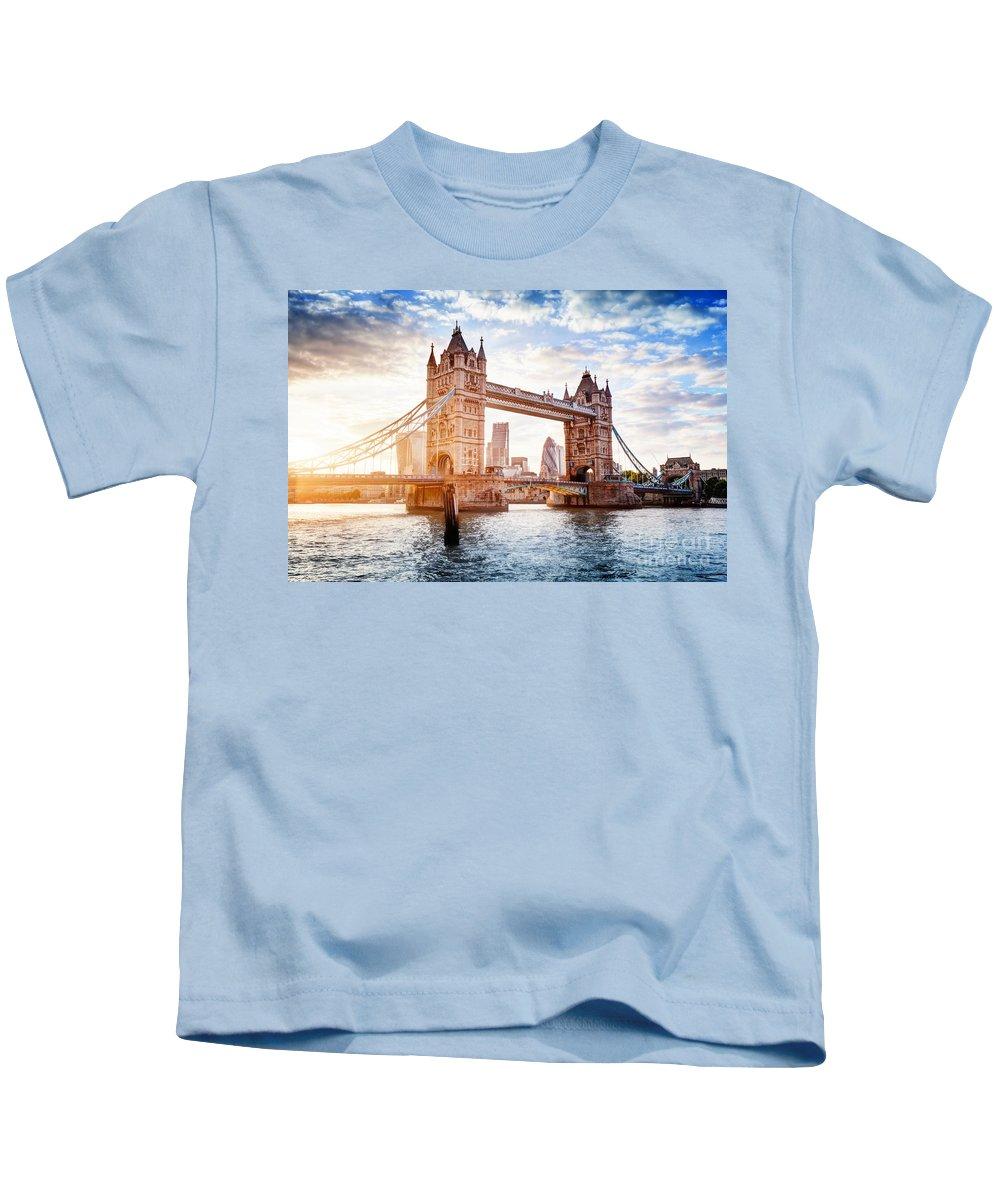 London Kids T-Shirt featuring the photograph Tower Bridge In London, The Uk At Sunset. Drawbridge Opening by Michal Bednarek
