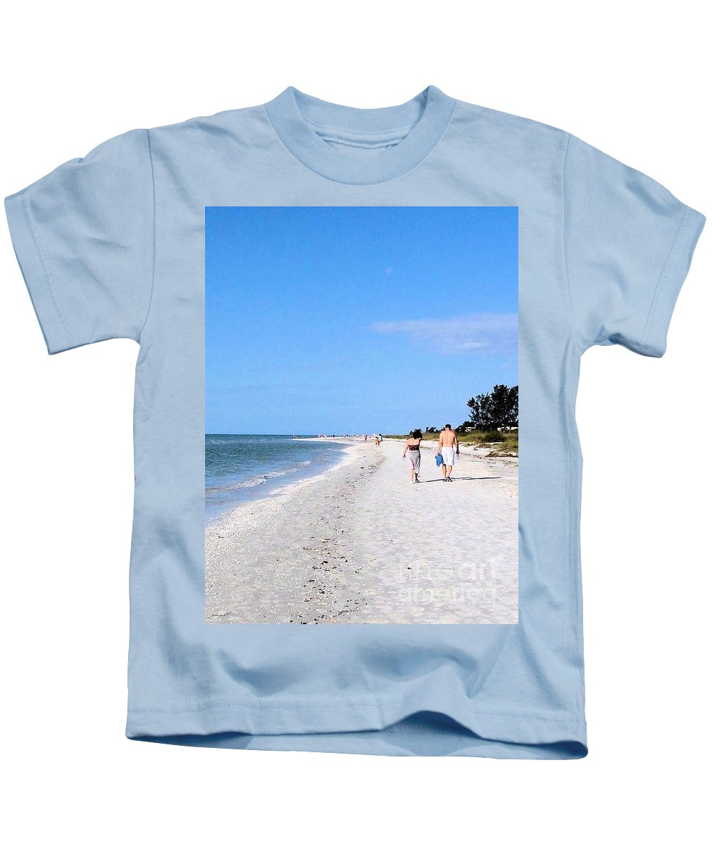 Sea Kids T-Shirt featuring the photograph Walking The Beach At Sanibel. by Janette Boyd