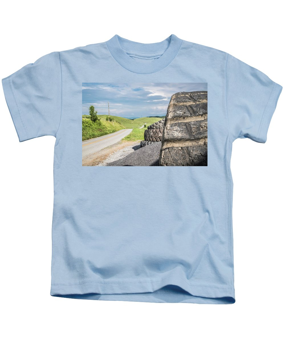 Tire Kids T-Shirt featuring the photograph Where The Rubber Meets The Road by Jim Love