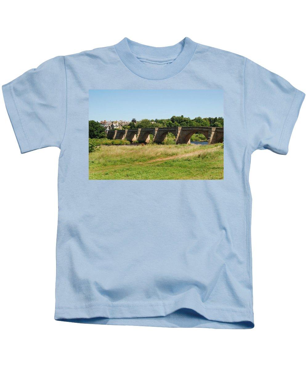 Corbridge Kids T-Shirt featuring the photograph bridge over river Tyne at Corbridge in summer by Victor Lord Denovan