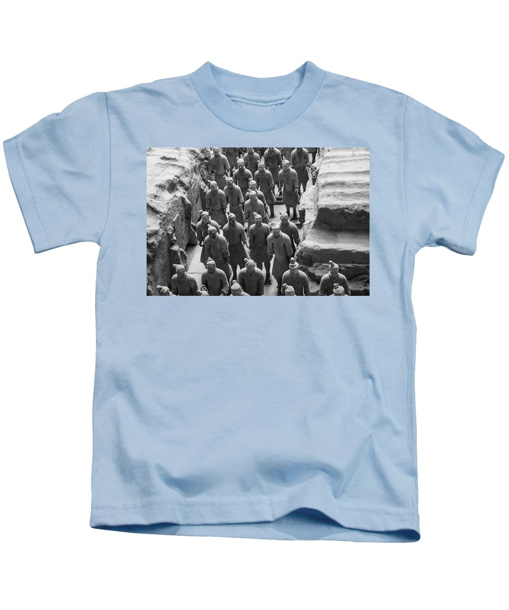 Warrior Kids T-Shirt featuring the photograph Pit 1 Of Terra Cotta Warriors In Black And White by Karen Foley