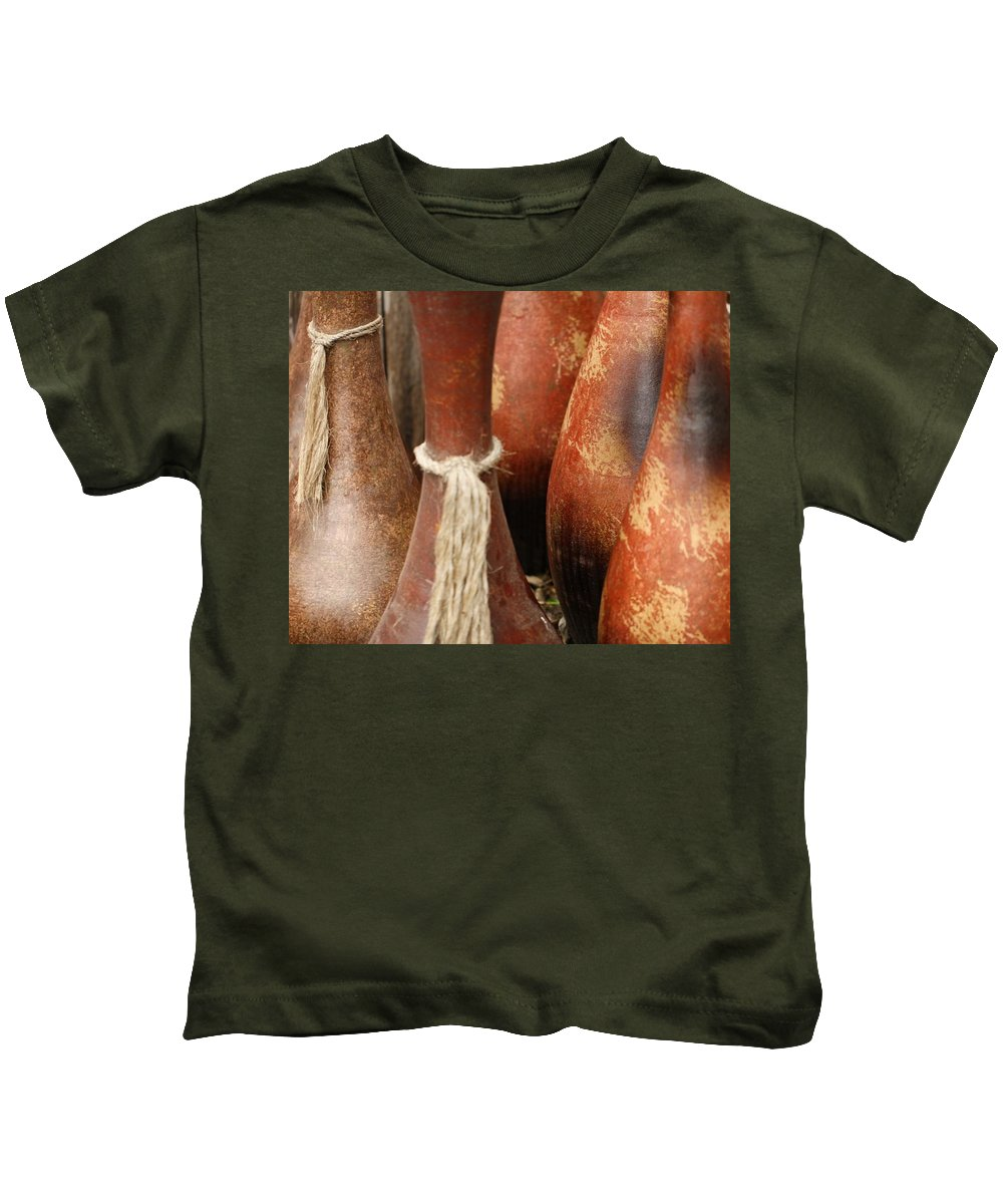 Pottery Kids T-Shirt featuring the photograph Pottery Jugs by Terry Fleckney