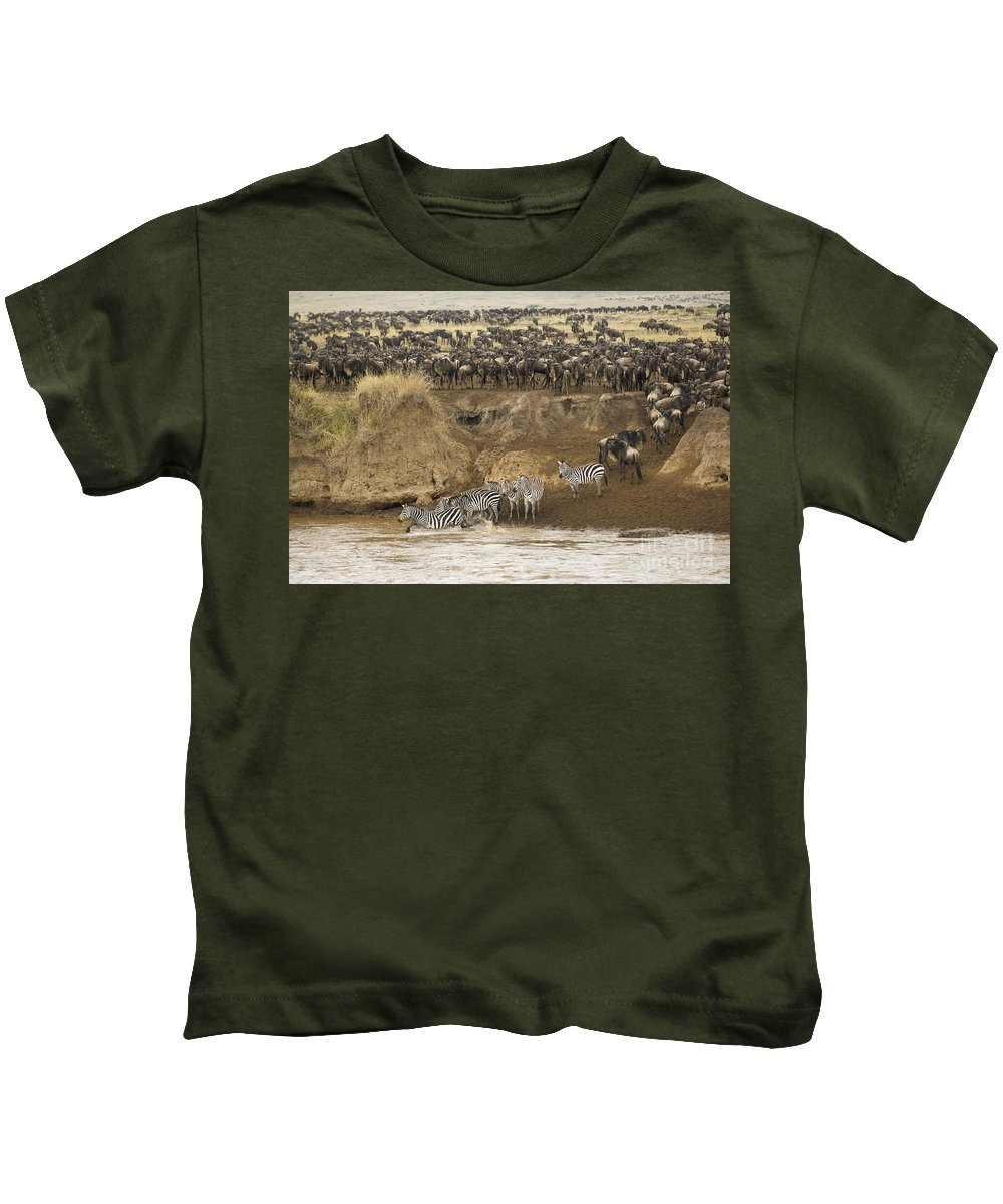 Africa Kids T-Shirt featuring the photograph Wildebeests Crossing Mara River, Kenya by John Shaw