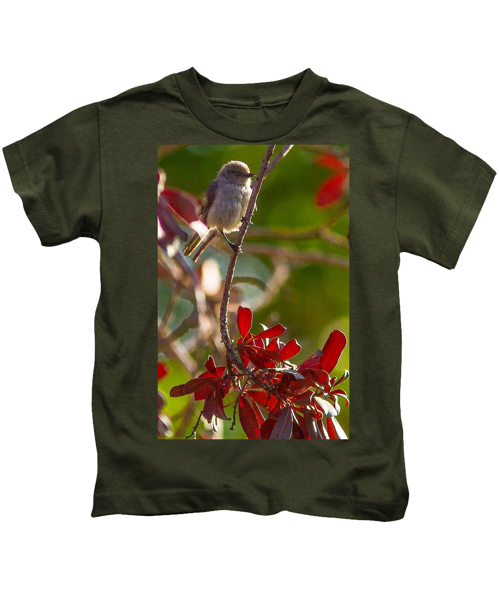 A Bushtit Bird Kids T-Shirt featuring the photograph A Bushtit Bird by Brian Williamson