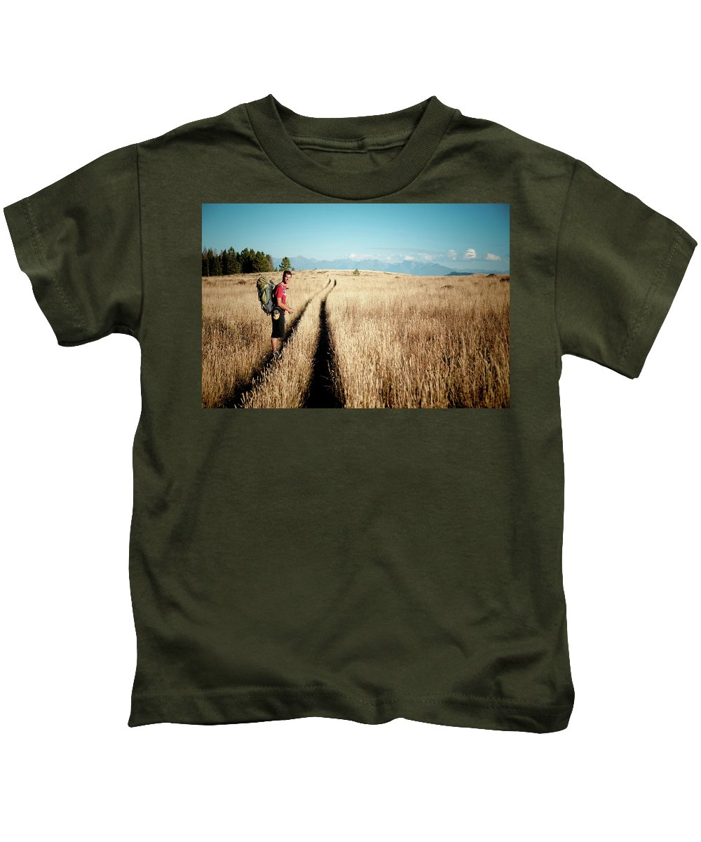 18-19 Years Kids T-Shirt featuring the photograph A Male Hiker In Montana by Meg Haywood-Sullivan