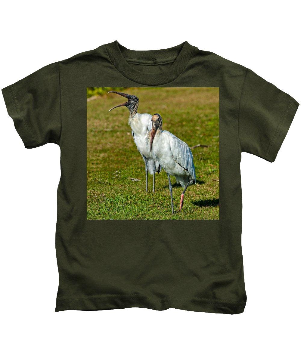 Birds Kids T-Shirt featuring the photograph A Serious Woodstork by John M Bailey
