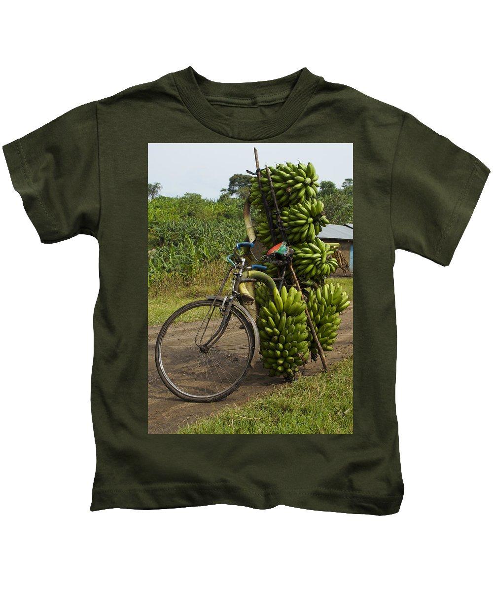 Ugandan Culture Kids T-Shirt featuring the photograph Banana Bike by Brian Kamprath