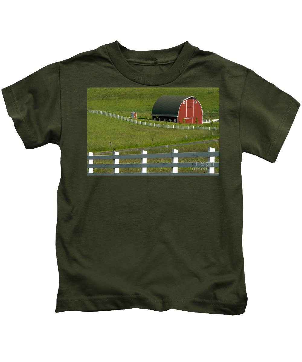 Palouse Area Kids T-Shirt featuring the photograph Big Barn Little Companion by Bob Phillips