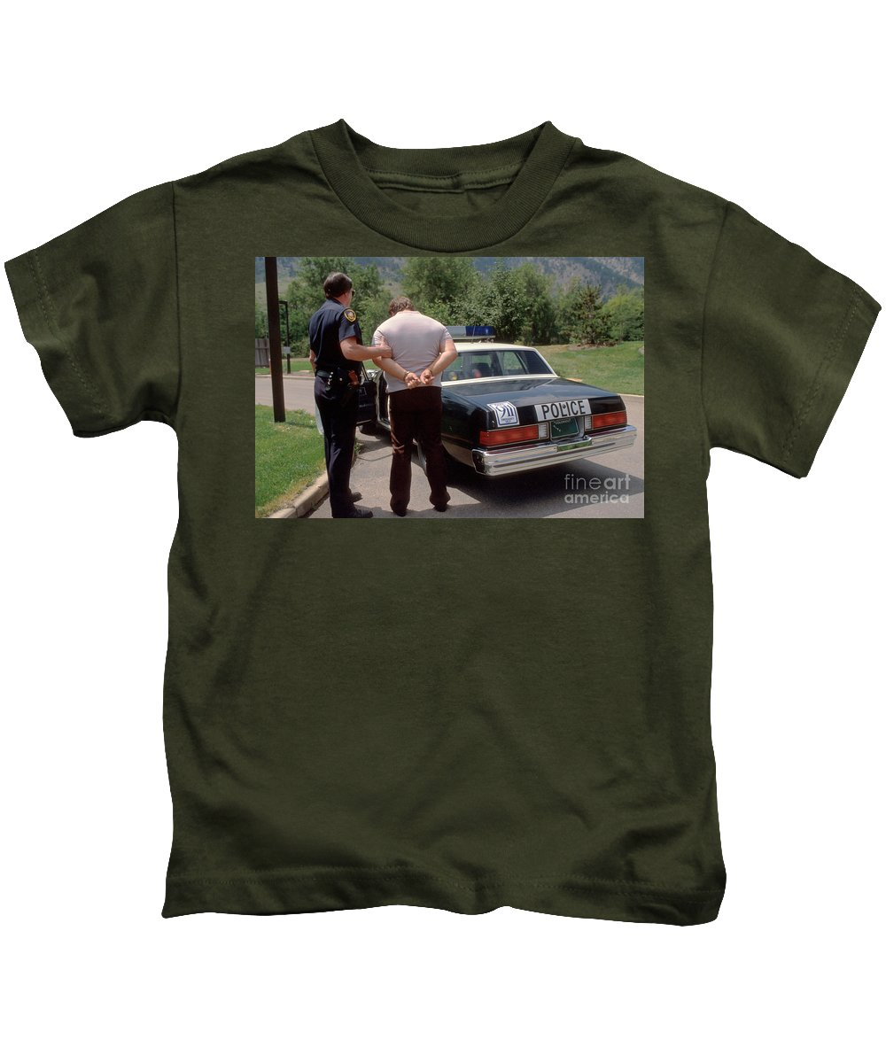 Police Kids T-Shirt featuring the painting Busted by Jerry McElroy