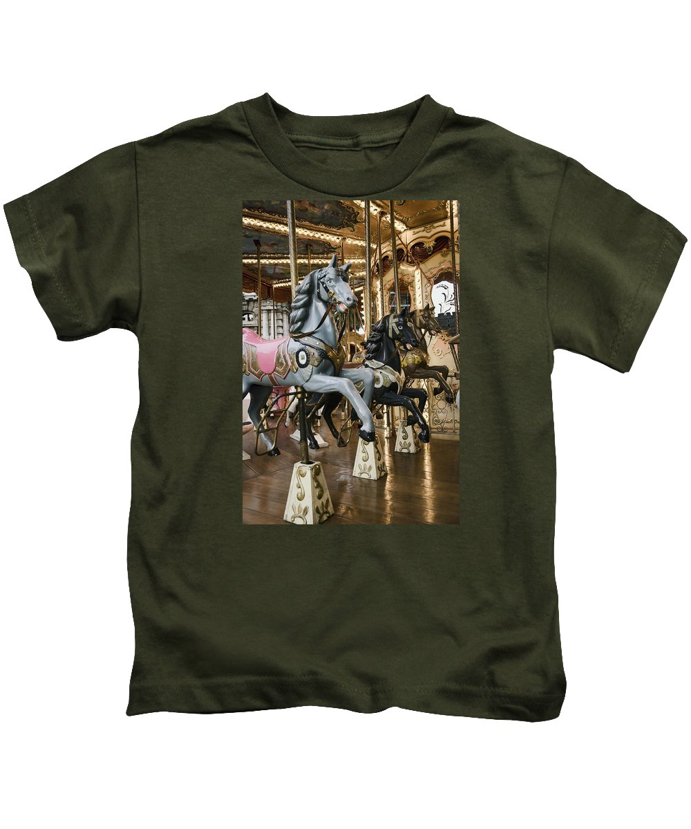 Carousel Kids T-Shirt featuring the photograph Carousel by Phyllis Taylor