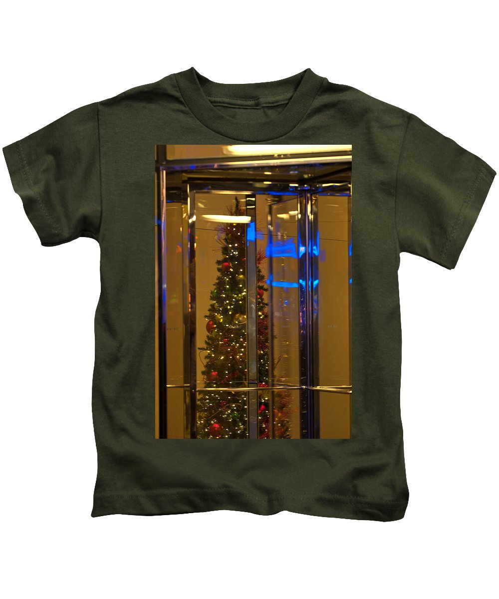 """""""new York City"""" Kids T-Shirt featuring the photograph Christmas Through The Revolving Door by Paul Mangold"""