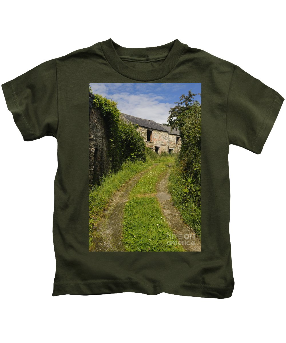 County Donegal Kids T-Shirt featuring the photograph Dirt Path To Stone Building by John Shaw