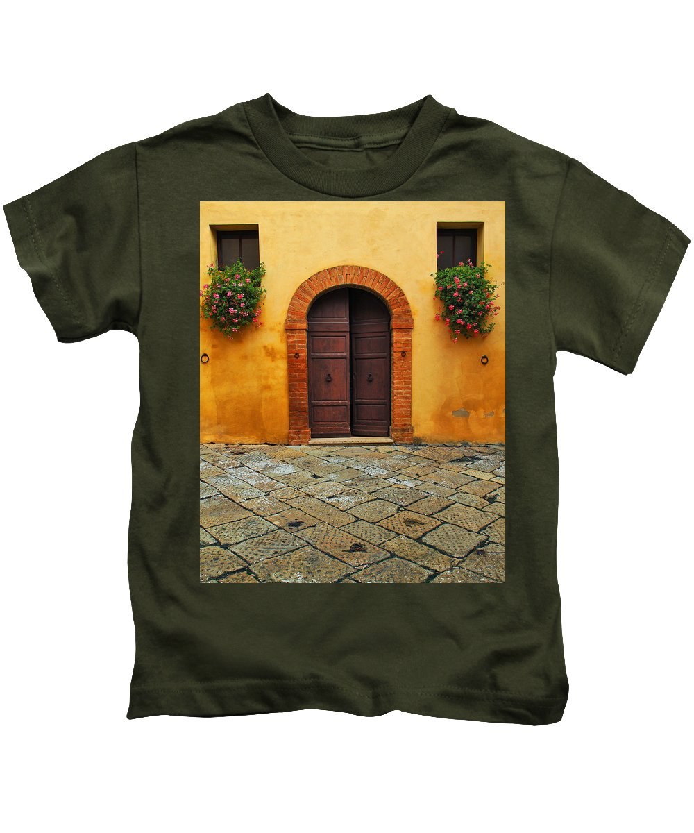 Door Kids T-Shirt featuring the photograph Door And Flowers In A Tuscan Courtyard by Greg Matchick