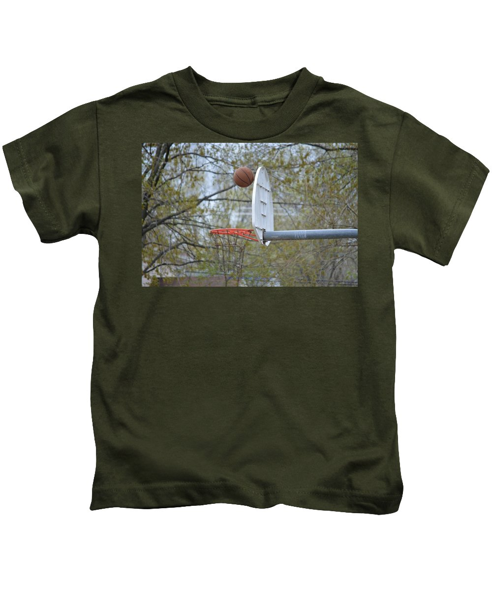 Basket Ball Kids T-Shirt featuring the photograph Dropping In by Sonali Gangane