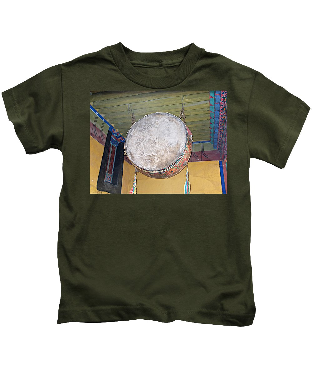 Drum Outside Former Living Quarters Of Dalai Lama In Potala Palace In Lhasa Kids T-Shirt featuring the photograph Drum Outside Former Living Quarters Of Dalai Lama In Potala Palace In Lhasa-tibet by Ruth Hager